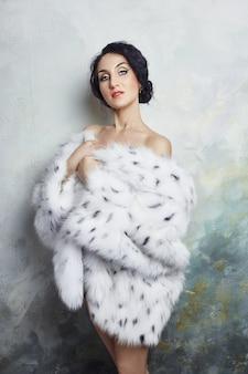 Abbigliamento invernale donna pelliccia di leopardo bianco pelliccia
