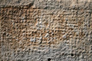 Acidato struttura in pietra incisa
