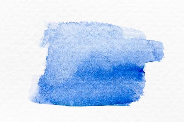 Acquerello di colore blu handdrawing come pennello o banner su carta in bianco