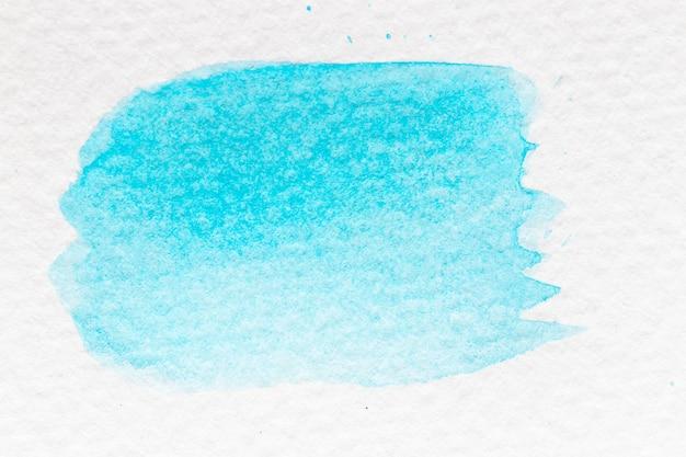 Acquerello di colore ciano o blu chiaro handdrawing come pennello o banner su sfondo di carta bianca