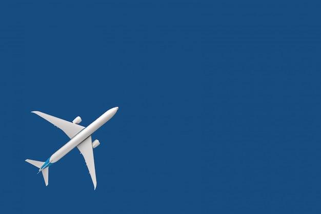 Aereo di modello, aereo di linea, aereo su sfondo blu. concetto di viaggio e trasporto