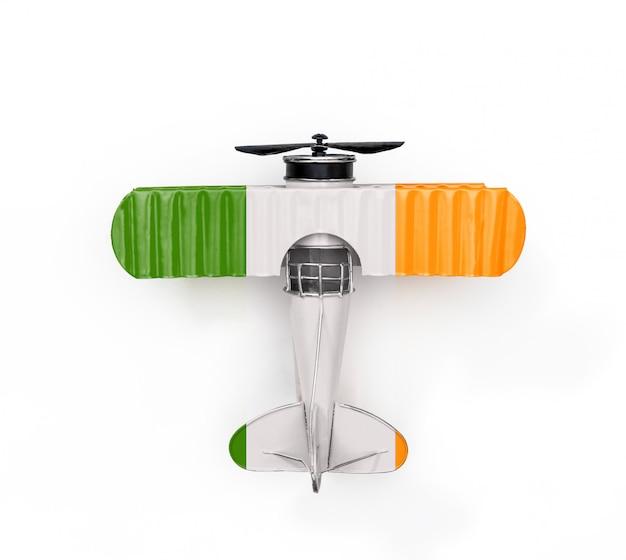 Aereo giocattolo del metallo del viaggio della bandiera nazionale dell'irlanda isolato su bianco