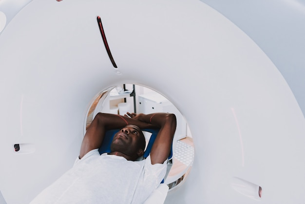 Afro patient inside tomography scan examination