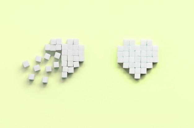 Alcuni cuori fatti di zollette di zucchero giacciono su un lime pastello alla moda