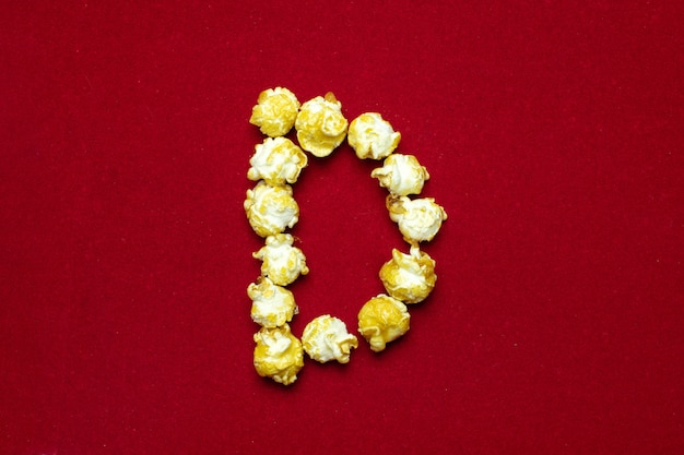Alfabeto inglese da sfondo di cinema popcorn, lettera d