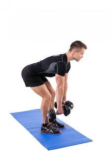 Allenamento di bent over dumbbells row in piedi