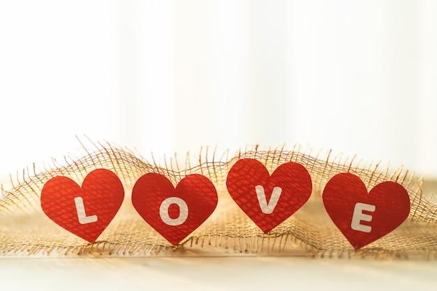 Amore quattro cuore rosso con sacco