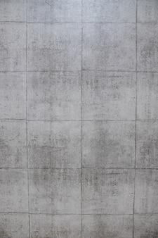 Ampio muro di mattoni grigi