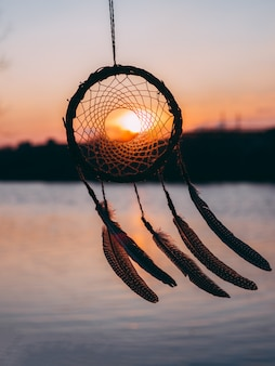 Amuleto etnico tramonto dreamcatcher, simbolo indiano