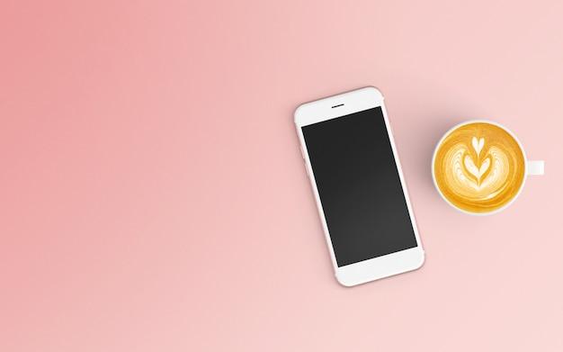 Area di lavoro moderna con tazza di caffè e smartphone sul colore rosa