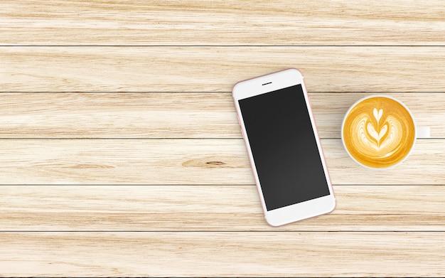 Area di lavoro moderna con tazza di caffè e tablet o smartphone su legno