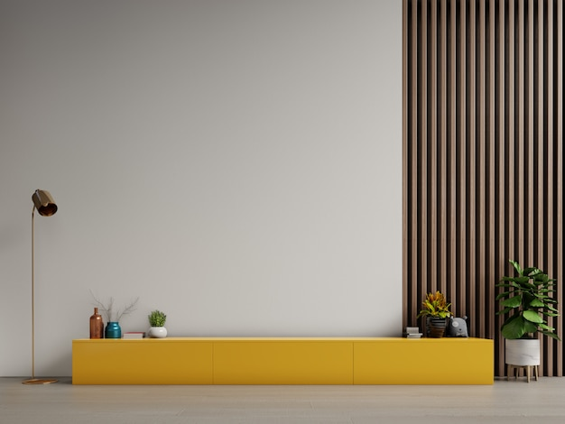 Armadietto per la tv o posizionare l'oggetto nel moderno salotto con lampada, tavolo, fiori e piante su sfondo bianco muro.