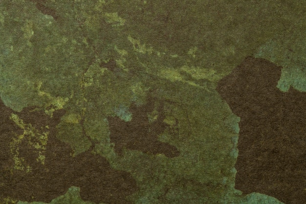 Arte astratta sfondo marrone scuro e colori verdi.