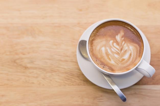 Arte calda latte caffè nella tabella