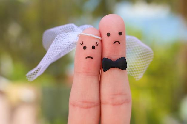 Arte delle dita di coppia. il concetto di matrimonio, donna e uomo deve sposarsi, ma non vogliono.