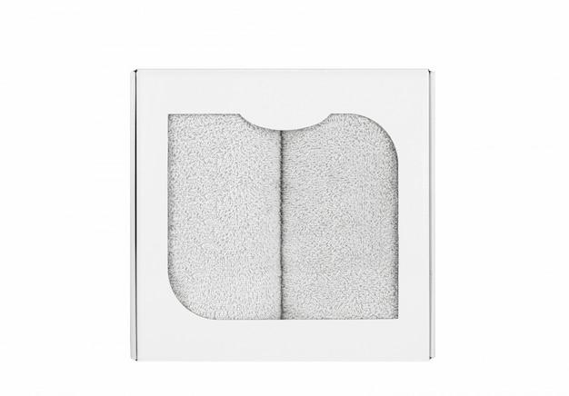 Asciugamani di spugna nella scatola di cartone