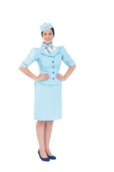 Assistente di volo piuttosto che sorride alla macchina fotografica