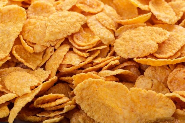 Assortimento dei fiocchi di mais come spazio della copia del fondo