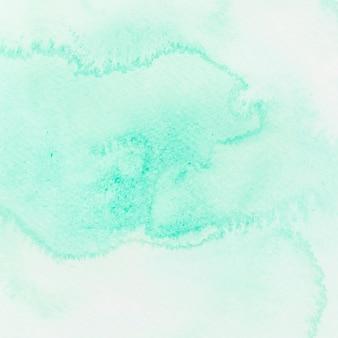 Astratto bagnato pennello verde dipinto sullo sfondo