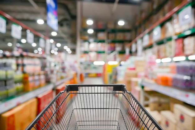 Astratto foto sfocata di negozio con carrello in bokeh sfondo del negozio di grandi magazzini