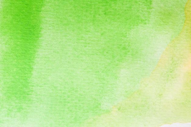 Astratto sfondo acquerello verde, giallo e bianco. pittura a mano d'arte