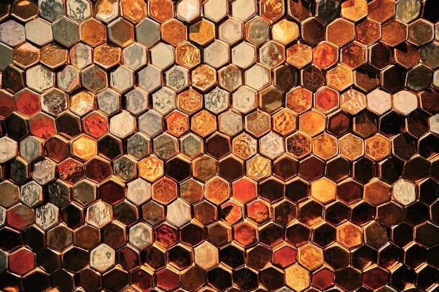 Astratto sfondo dorato, cellule d'oro e pentagoni