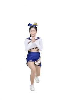 Attraente cheerleader asiatica in azione