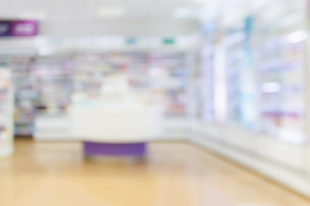 Backbround astratto della sfuocatura della farmacia della farmacia con la medicina e il prodotto sanitario sugli scaffali