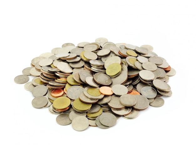 Bagni tailandesi della moneta sulla parete bianca