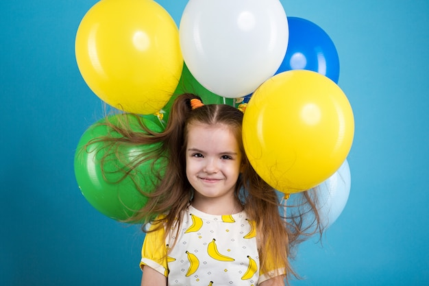 Bambina con baloons