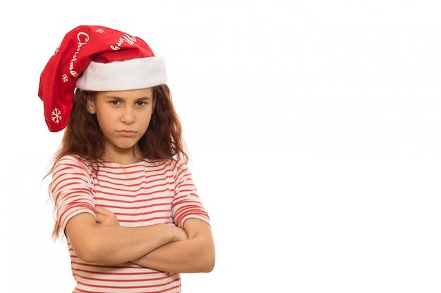 Bambina santa in un cappello di natale