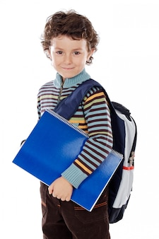 Bambino adorabile che studia una priorità bassa eccessiva bianca