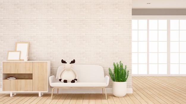 Bambola della renna sul sofà in salone - interior design per materiale illustrativo - rappresentazione 3d