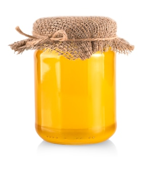 Banca del miele isolata su fondo bianco