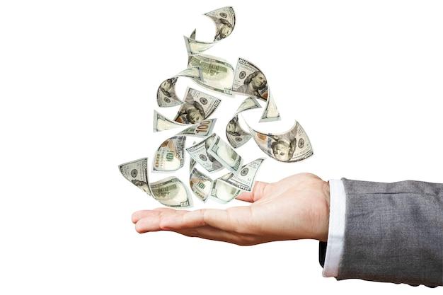 Banconota del dollaro americano che vola a disposizione dell'uomo d'affari