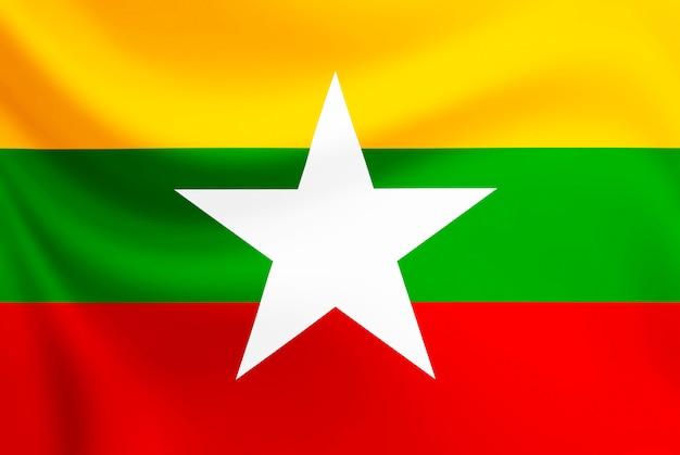 Bandiera del myanmar che ondeggia sul tessuto di struttura.