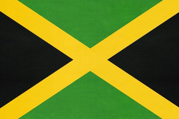 Bandiera del tessuto nazionale giamaica, sfondo tessile. simbolo del paese nordamericano.