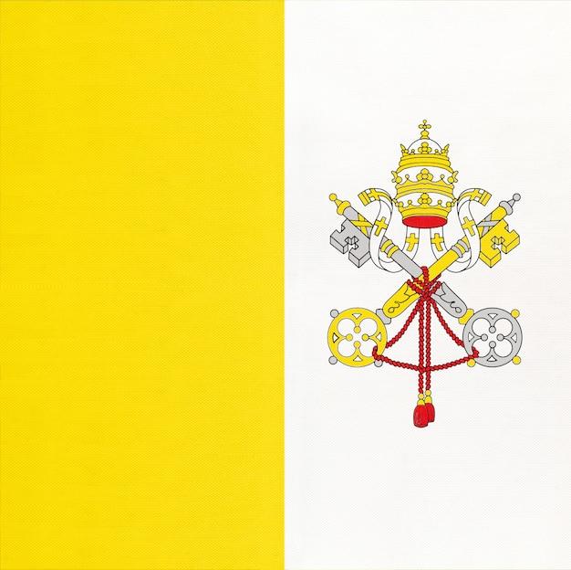 Bandiera del tessuto nazionale vaticano, sfondo tessile. segno ufficiale dello stato italiano.