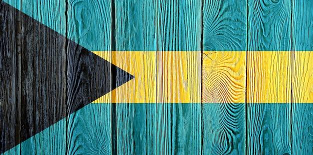 Bandiera delle bahamas dipinta sul vecchio fondo di legno della plancia