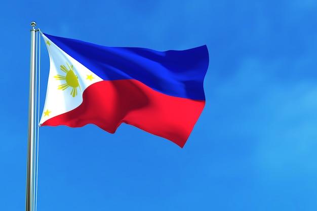 Bandiera delle filippine sullo sfondo del cielo blu