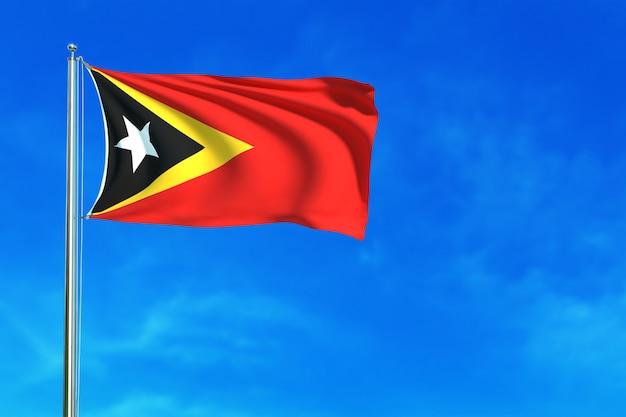 Bandiera di timor est sulla rappresentazione del fondo 3d del cielo blu