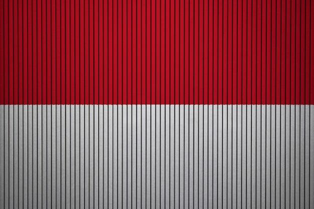 Bandiera nazionale dipinta dell'indonesia su un muro di cemento