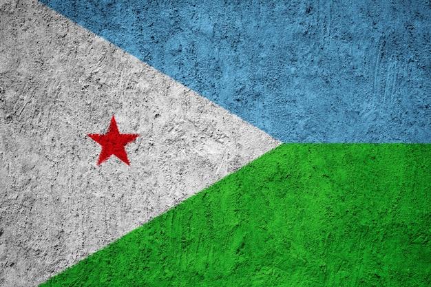 Bandiera nazionale dipinta di gibuti su un muro di cemento