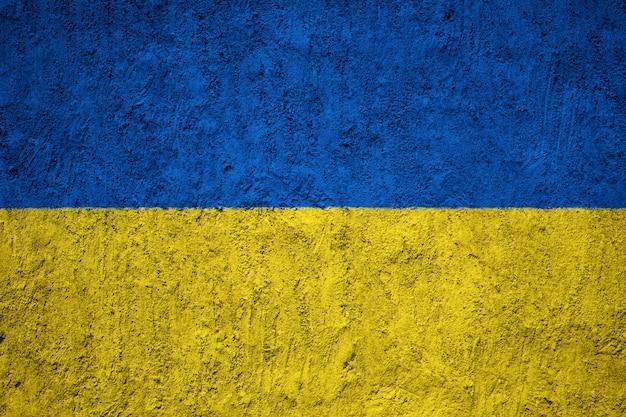 Bandiera ucraina dipinta sulla parete del grunge