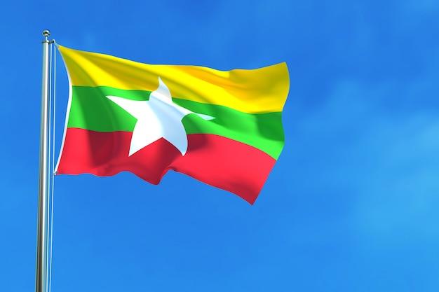 Bandierina del myanmar (birmania) sui precedenti del cielo blu