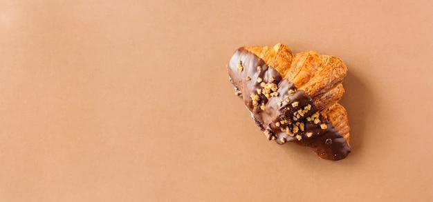Banner di cornetto al cioccolato.