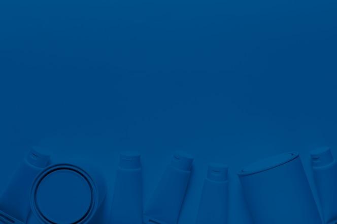 Barattolo e contenitori di pittura di vista superiore su colore blu classico