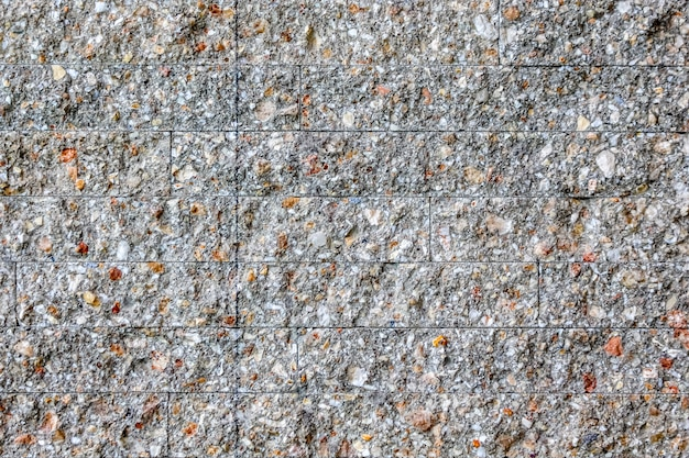 Bastone di mattoni di pietra nel muro