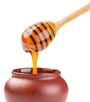 Bastone di miele sulla superficie bianca