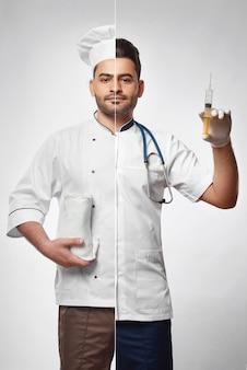 Bel giovane barbuto vestito come uno chef di cucina e medico professione professione cibo nutrizione dieta sanitaria alimentazione biologica medicina vitalità benessere felicità carriera.